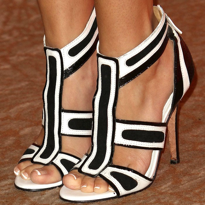 Ashley Tisdale wearing black and white LAMB sandals