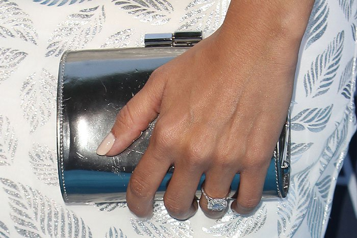 Ashley Tisdale's cushion-cut diamond engagement ring and silver clutch