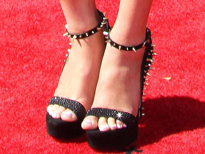 Carissa Moore wearing spiked suede platform sandals