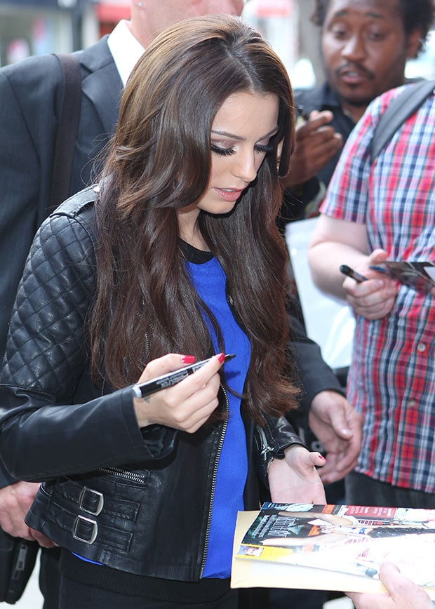 Cher Lloyd signs autographs in a quilted black leather jacket