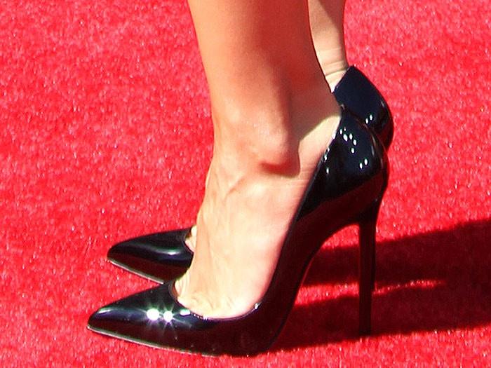 Cheryl Burke wearing Christian Louboutin Pigalle patent pumps