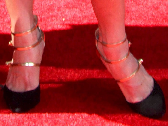 Danyelle Wolf wearing three gold strap pumps