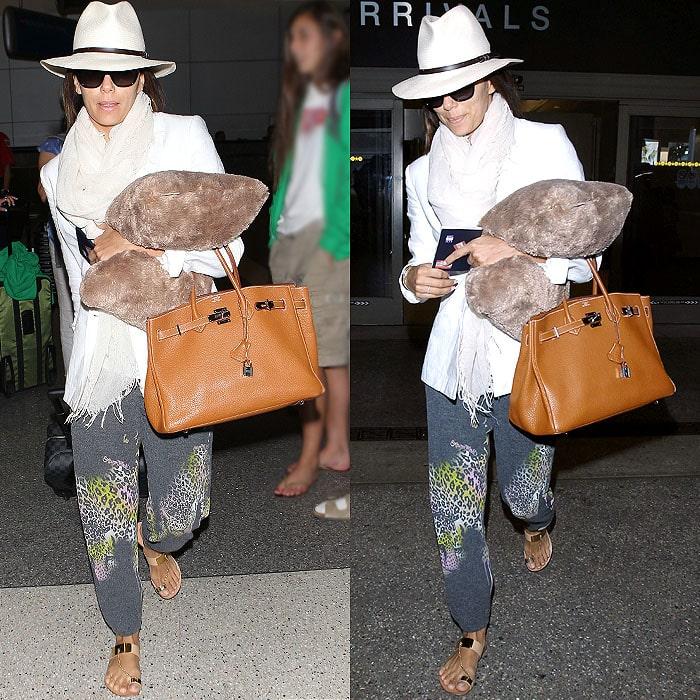 Eva Longoria wearing cheetah-print sweatpants