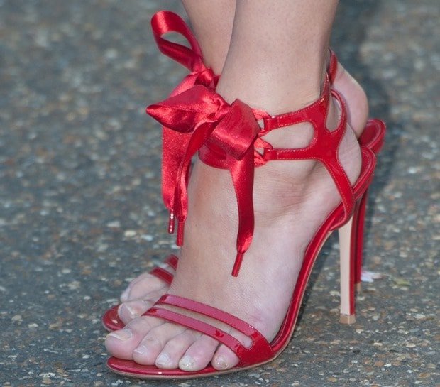 Gemma Arterton wearing an equally gorgeous pair of red ribbon-ankle-tie sandals