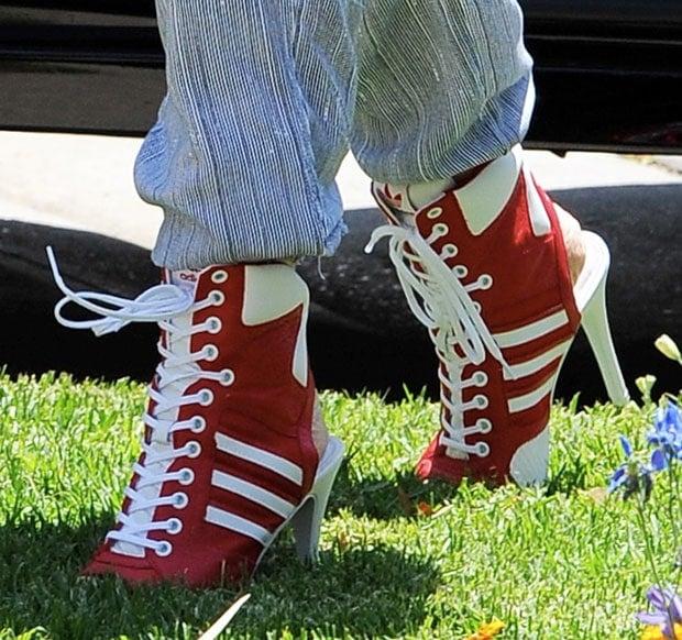 Gwen Stefani wearing Jeremy Scott for adidas high-heel sneakers