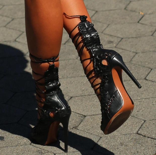 Irina Shayk wearing Alaia sandals withsmall woven cutouts