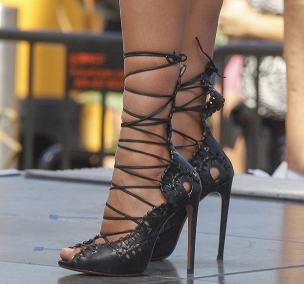 Irina Shayk shows off her feet in black heels