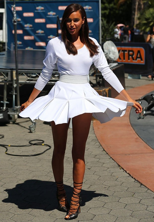 Irina Shayk rocks a white Azzedine Alaia long-sleeved dress