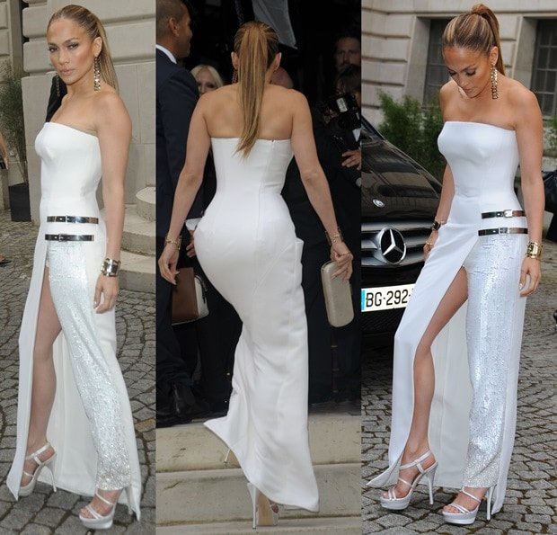 Jennifer Lopez in a white strapless, buckle-skirted jumpsuit from Atelier Versace and white platform sandals from the same brand
