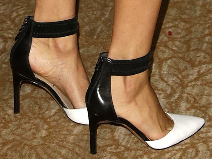 Karla Souza wearing black and white ankle strap pumps
