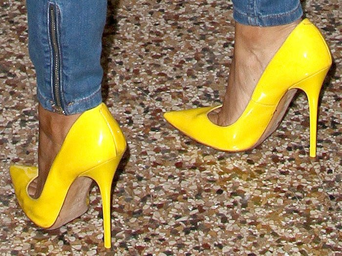 Karrueche Tran yellow patent pumps