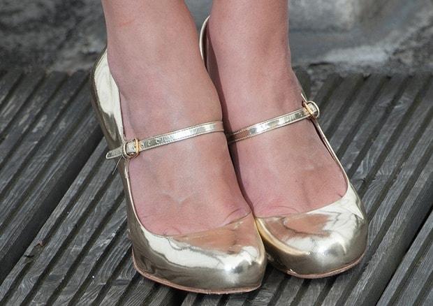 Keira Knightley wearing gold Prada Mary Jane pumps