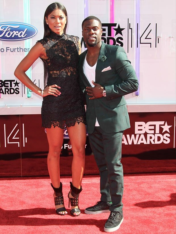 Eniko Parrish in a sheer lace dress and Kevin Hart in a green suit