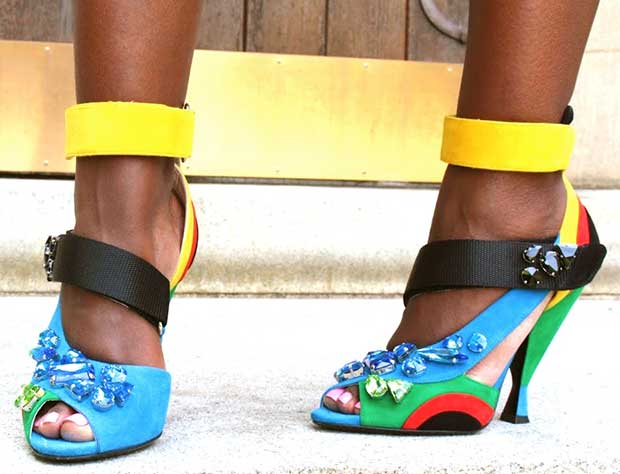 Liz shows off her feet in multicolored and bejeweled heels by Prada