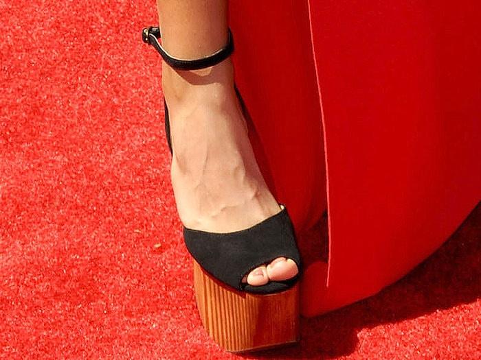 Lolo Jones wearing heel-less platform sandals