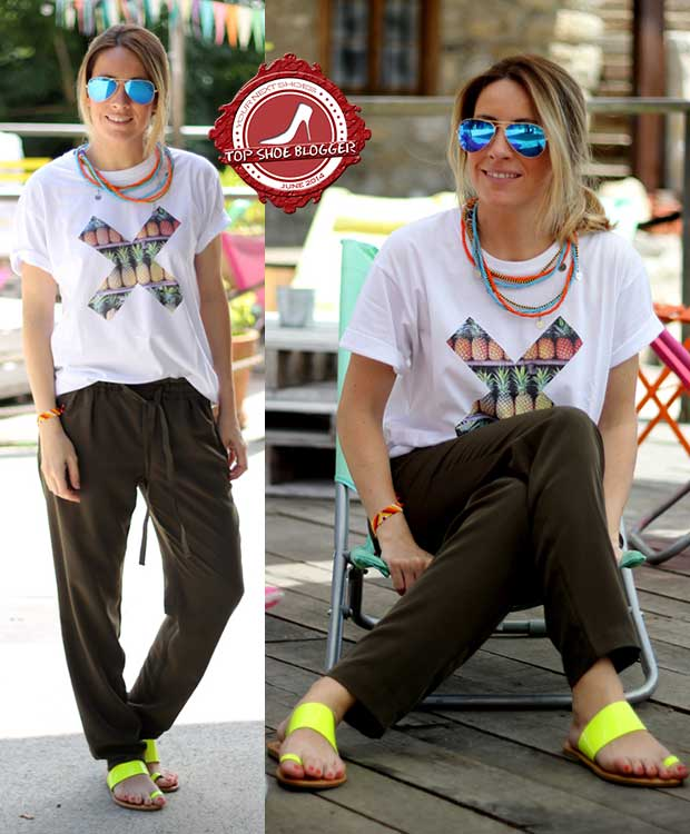 Monica styled neon yellow flat toe-ring sandals with baggy pants
