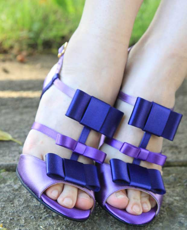 Natalia shows off her toes in purple bow sandals