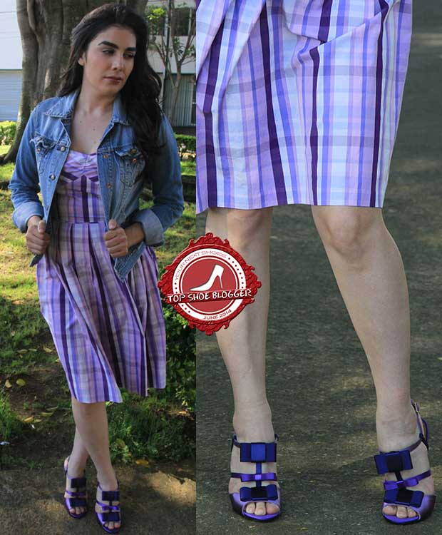 Natalia flashes her legs in an all-purple ensemble