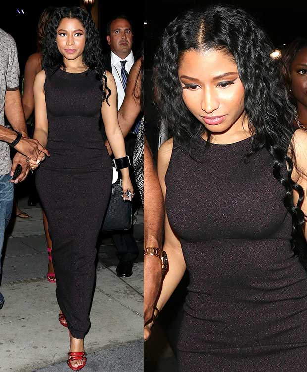 Nicki Minaj left the venue in a glittery but simple black dress styled with a pair of red heels by Anthony Vaccarello