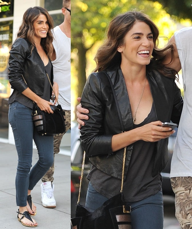 Nikki went glam-casual by wearing a simple black tee with blue denims and then topping the combo with a leather jacket, a gold chain-strap purse, and a pair of comfy flat thong sandals