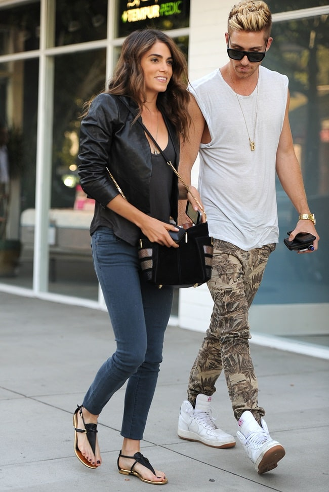 Nikki was caught looking extremely happy as she hung out with a male friend