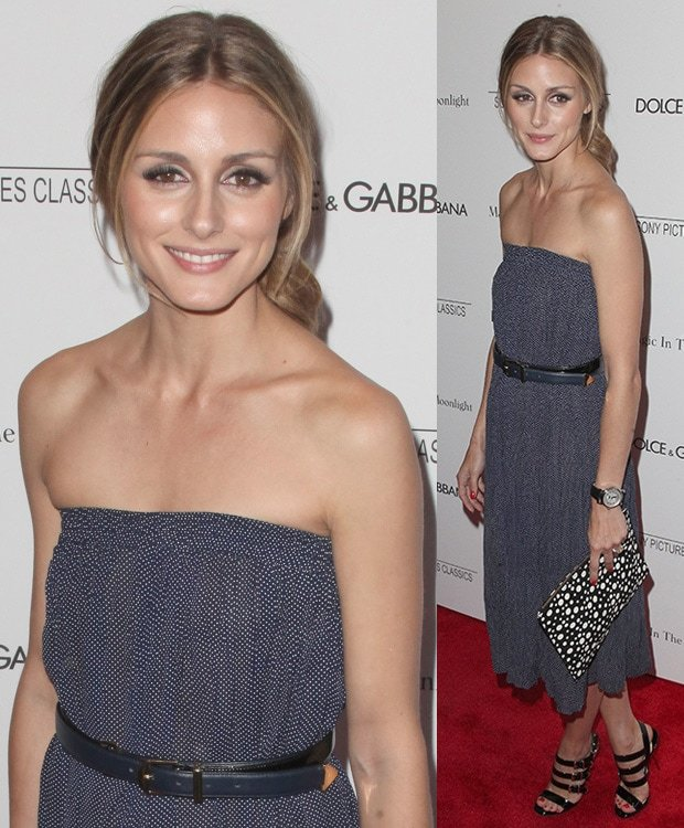 Olivia Palermo in a navy blue patterned strapless dress styled with a matching leather belt