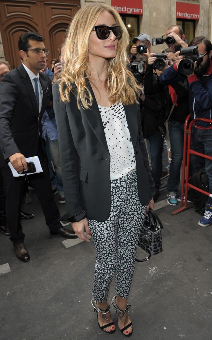 Olivia Palermo wearing a mixed-print three-piece outfit and crystal-detailed lace-up sandals