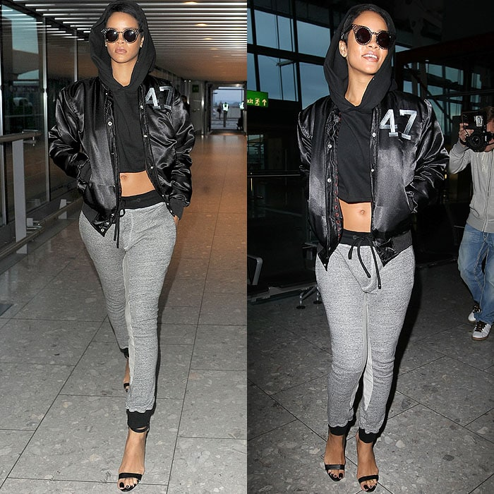 Rihanna in a satin bomber jacket, a cropped hoodie, slim sweatpants, and Manolo Blahnik 'Chaos' sandals