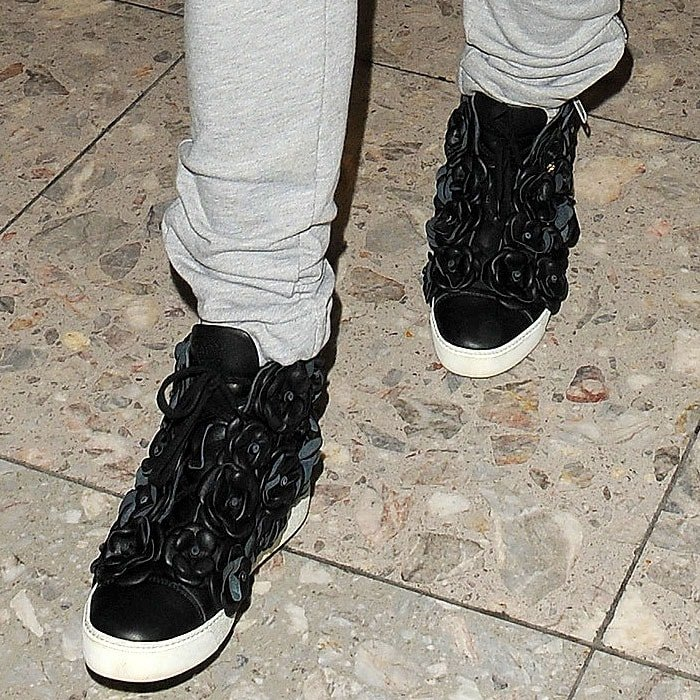 Rita Ora wearing Chanel Camellias sneakers
