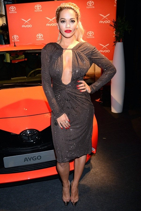 Rita Ora in a shimmering plunging dress from Emilio Pucci at the Toyota Aygo premiere at Pearl Club in Berlin, Germany, on July 2, 2014