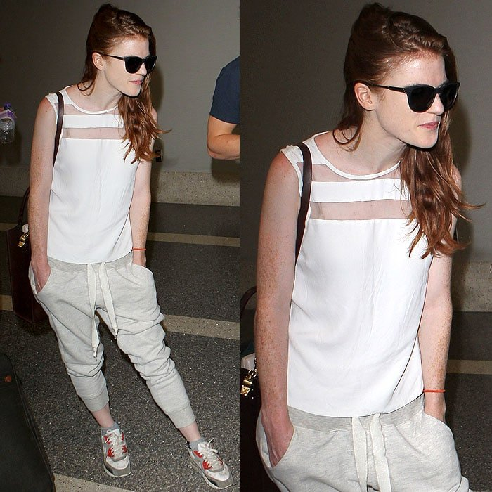 Rose Leslie in a styled-down silk top and pushed-up sweatpants