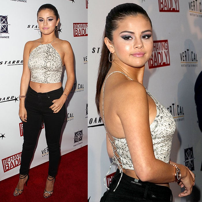 Selena Gomez showing off flat abs and the sexy corset back of her Zimmermann snakeskin halter top