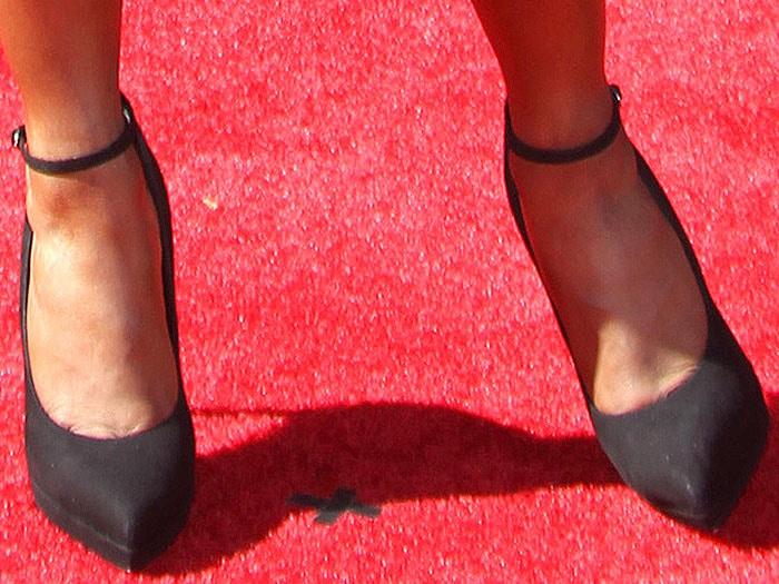 Sloane Stephens wearing Giuseppe Zanotti ankle strap pumps