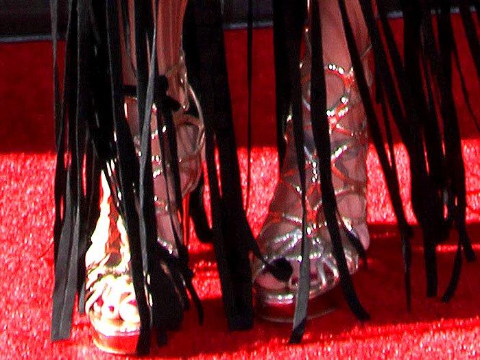 Sydney Leroux wearing gold cage sandals