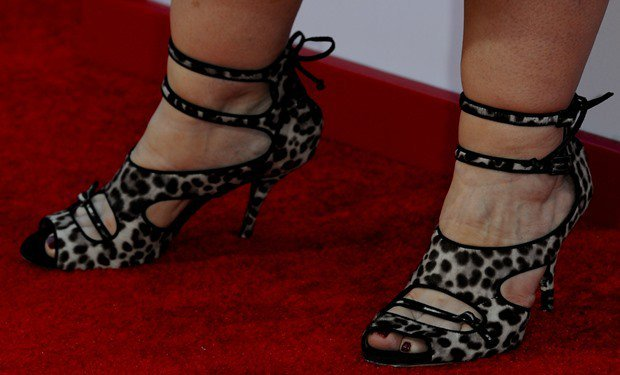 Melissa McCarthy's feet in Tabitha Simmons Bailey double-wrap sandals in leopard print and calf hair