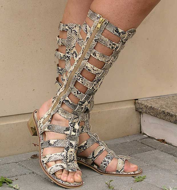 Teresa shows off her feet in snakeskin gladiator sandals