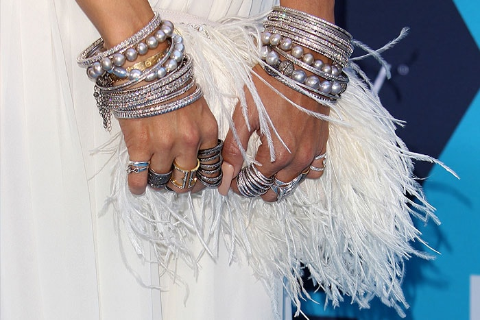 "Vanessa Hudgens' Jenny Packham ""Tinta"" silk-and-feather clutch"