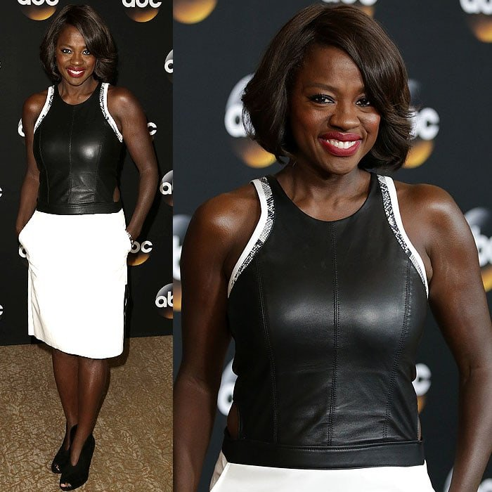 Viola Davis brought the edge in a Helmut Lang leather-top mini dress with waist cutouts and fierce plunge-front peep-toe booties