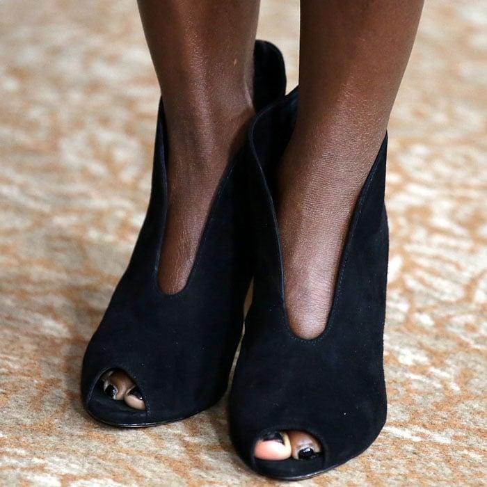 Viola Davis wearing black suede peep toe ankle boots