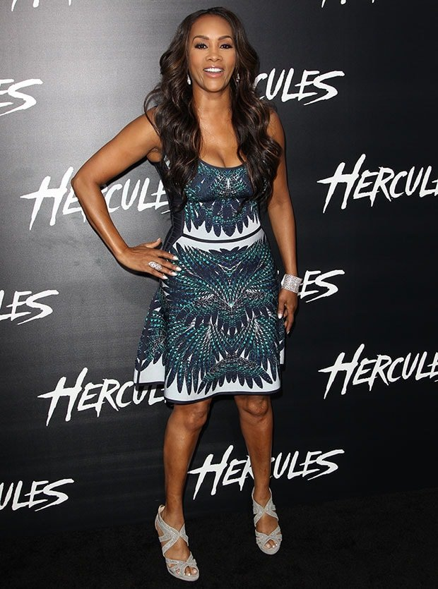 Vivica A. Fox in a printed knit dress by Herve Leger featuring a low scoop neckline, bandage sides, and an A-line skirt with a flared hem