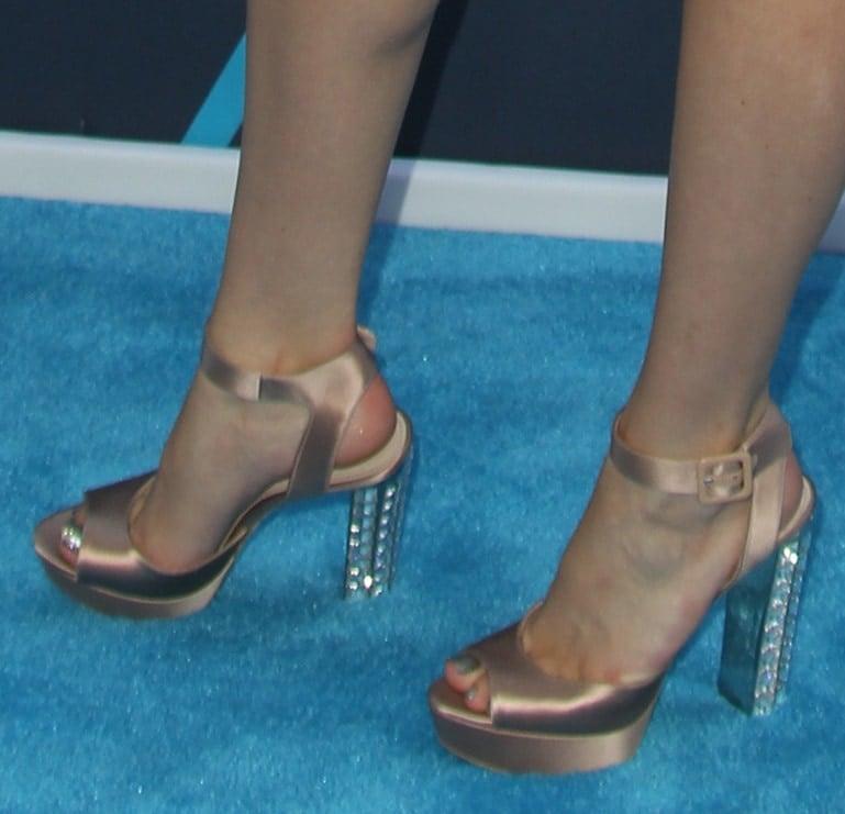 A closeup shot of Bella's bejeweled Miu Miu sandals
