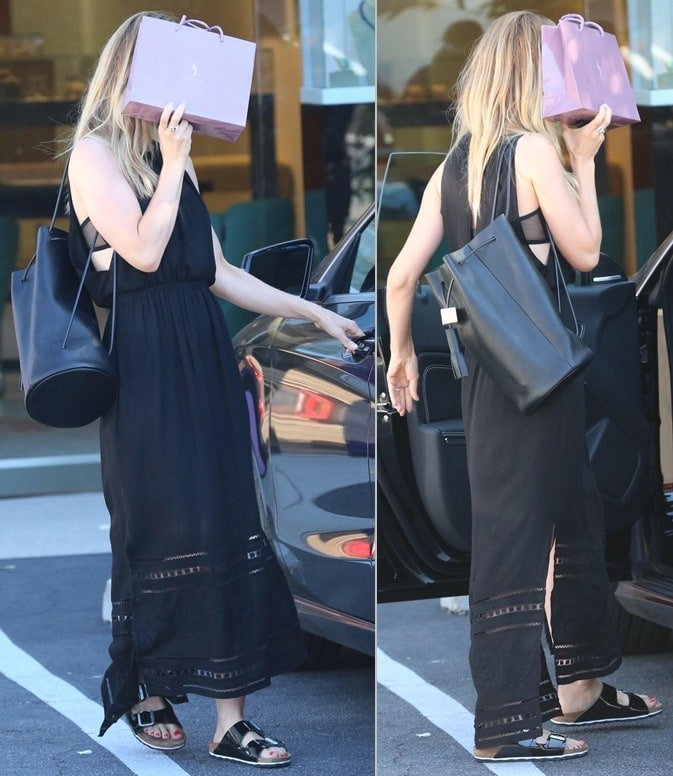 Mena Suvari sported a long black frock with the sandals while buying a gift at Suzanne Felsen Jewelry Store in Los Angeles