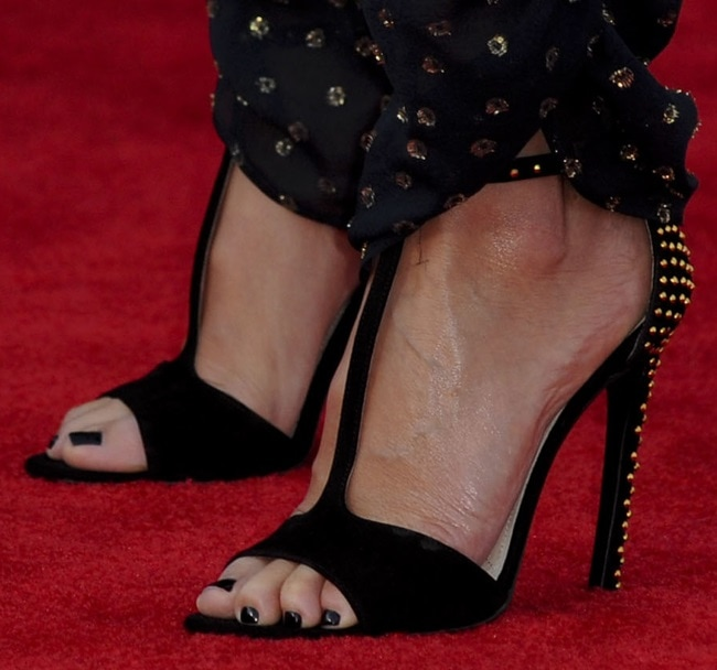 A closer look at Cameron's studded t-strap sandals from Prada