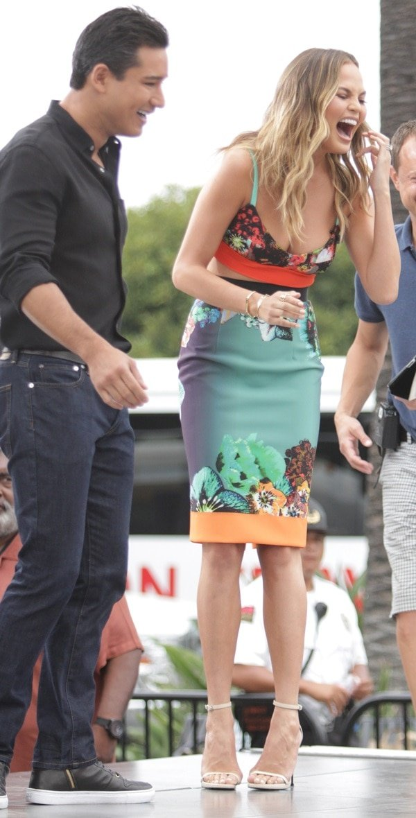 Chrissy Teigen with Mario Lopez on the set of 'Extra' at Universal City Walk in Los Angeles, California, on July 16, 2014
