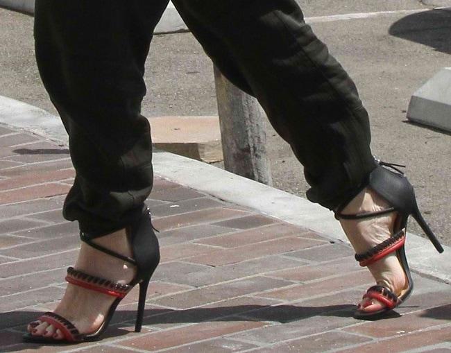 Gwen Stefani in whipstitch-detailed crisscross ankle-strap sandals