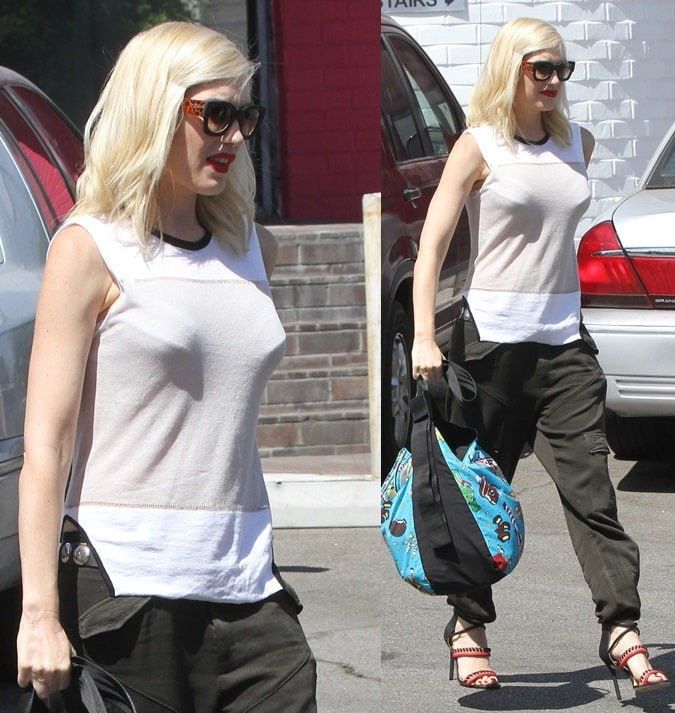 Gwen Stefani in army-green slouchy pants while running errands