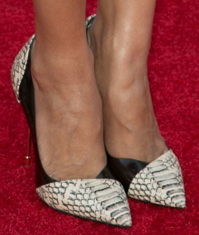 Hannah Simone wearing striking mixed-media pumps crafted in black and snake-print leather from Kurt Geiger