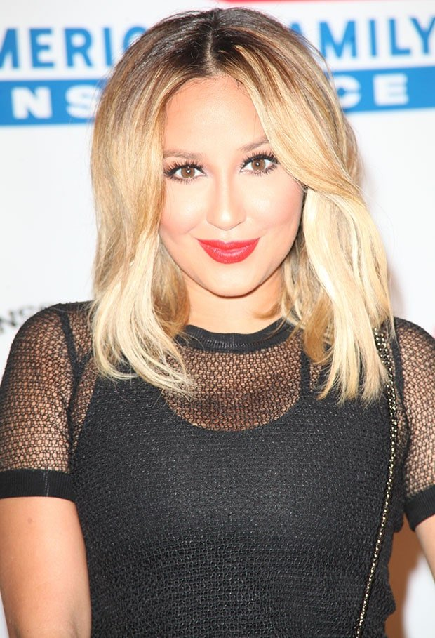 Adrienne Bailon with dark eye makeup and red lip shade