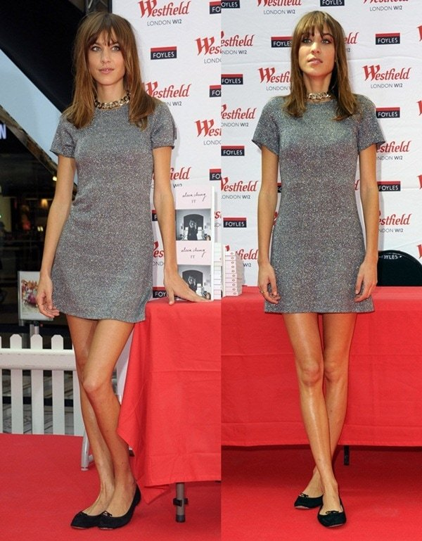 Alexa Chung in a simple gray jersey dress and a chunky silver chain necklace