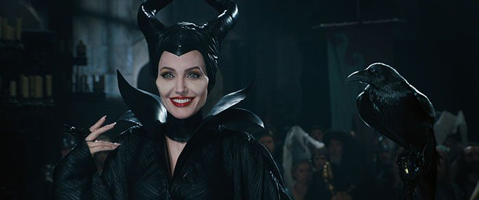 Angelina Jolie as Maleficent and her shapeshifting crow, Diaval, in a still from Walt Disney Pictures' 2014 film Maleficent